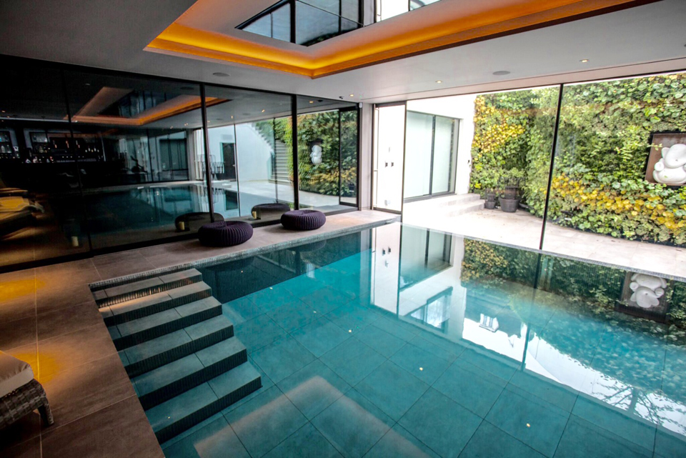Swimming pool indoor movable lifting pool floor - Houses with swimming pools in london ...